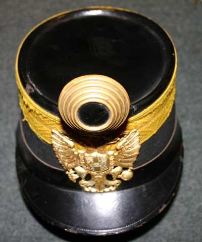 chivar (chipiu inalt, folosit in trecut de militarii austro-ungari Kaiserlich Und Königlich K.U.K) .